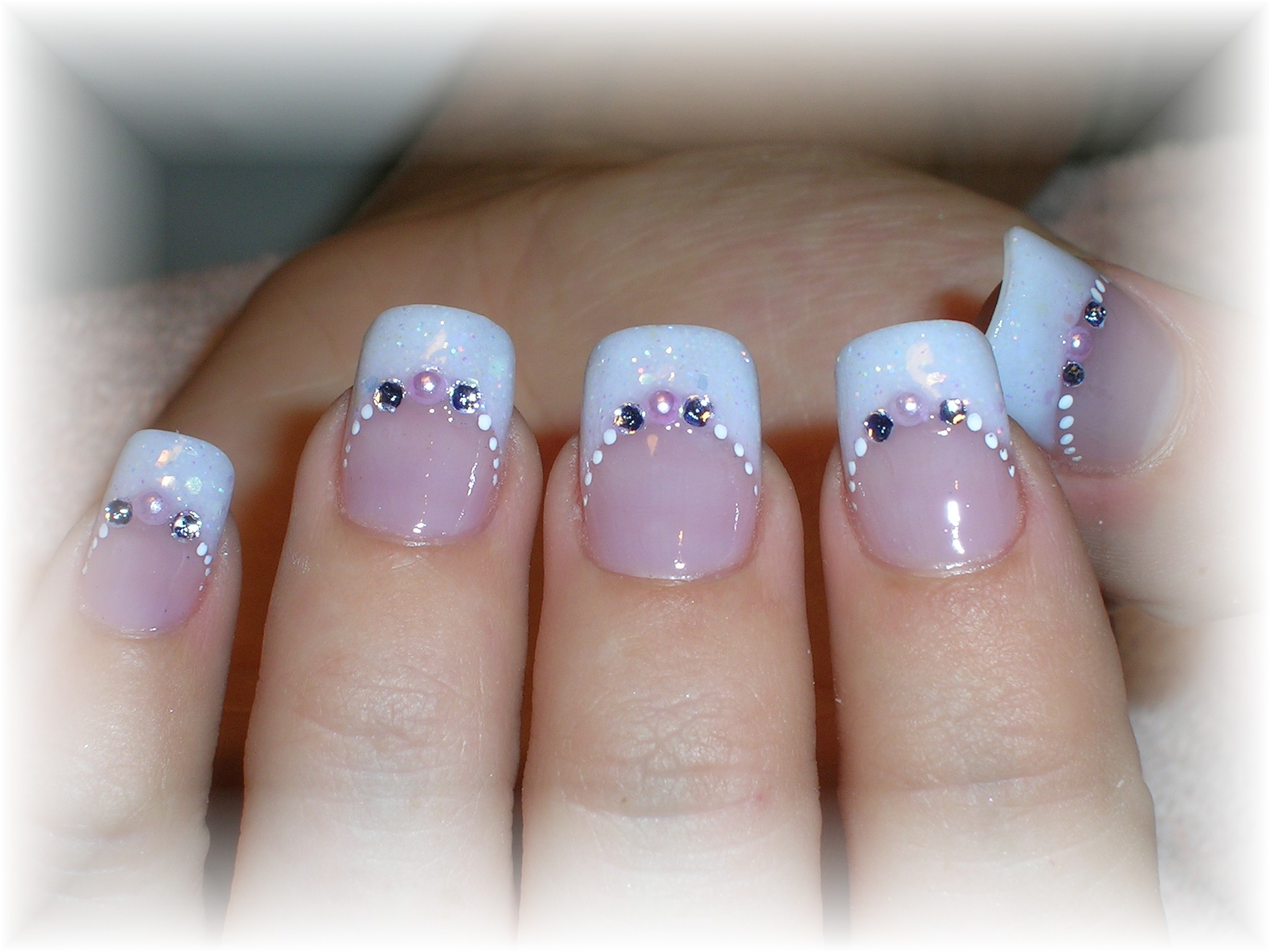 French opal glitter acrylic tip and overlay with smile line adorned ...